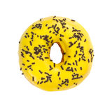 Donut with yellow glaze and chocolate sprinkles Royalty Free Stock Photography
