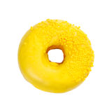 Donut with yellow glaze and sprinkles Stock Photos