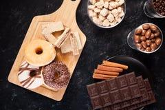 Donuts, арахисы в шоколаде и кофейные зерна Стоковое Изображение