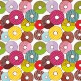 Donuts безшовной картины сладостные установленные при изолированные замороженность и sprinkls, пастельные цвета на белой предпосы Стоковое Изображение RF