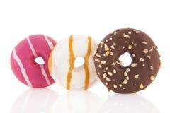 Donuts в пинке, белизне и шоколаде Стоковое Фото