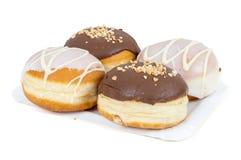 Donuts застекленные и шоколад на бумажном подносе Стоковые Изображения RF
