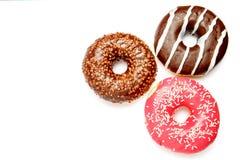3 Donuts изолированного на белизне Стоковая Фотография