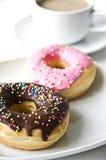 Donuts и кофейная чашка Стоковая Фотография