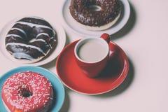 Donuts и чашка кофе Стоковые Изображения