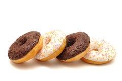 Donuts на белой предпосылке Стоковые Фото