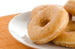 Donuts на плите Стоковая Фотография