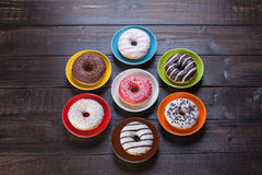 Donuts на таблице Стоковые Фото