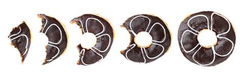donuts при отсутствующий укус изолированный на белизне Стоковые Изображения