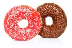 Donuts с брызгают на белой предпосылке Стоковая Фотография