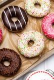 Donuts с шоколадом и замороженностью Стоковое Изображение RF