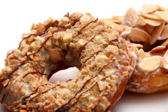 Donuts. Closeup donuts with nuts topping royalty free stock photos