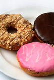 Donuts. Closeup donuts in different flavors royalty free stock images
