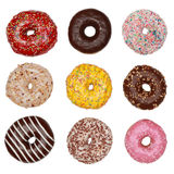 Donuts. Collection of many colored donuts isolated on white Stock Image