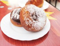 Donuts. Two donuts: one with chocolate and another with sugar powder Royalty Free Stock Images