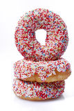 Donuts. Tower in fotn of a white background Royalty Free Stock Photo