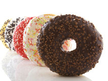 The donuts. Several donuts on a white background Stock Photos