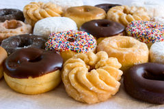 Donuts - an assortment. Assortment of fresh donuts - focus on front donut Royalty Free Stock Photos