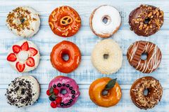 Donuts In assortment, on old wood background. Top view. Space for text.  stock photos