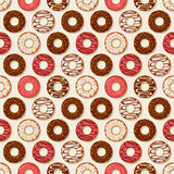Donuts background. Vector seamless pattern. Stock Photos