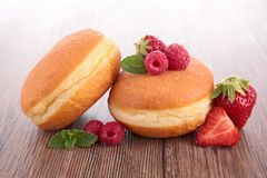 Donuts and berry Stock Image