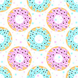 Donuts with blue and pink icing Royalty Free Stock Image