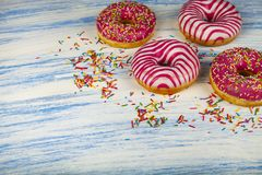 Donuts on a blue wooden background royalty free stock image