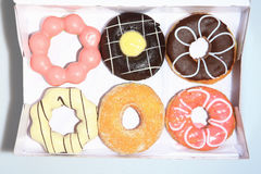 Donuts in the box. Donuts in the box, as white background or print card Royalty Free Stock Images