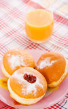 Donuts breackfast. Tasty Donut and oringe juice Royalty Free Stock Images