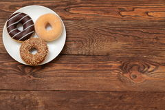 Donuts. Buds are sweets which you can not resist Royalty Free Stock Photography
