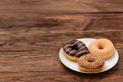 Donuts. Buds are sweets which you can not resist Royalty Free Stock Image