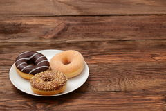 Donuts. Buds are sweets which you can not resist Stock Photo