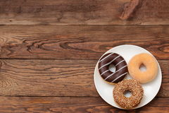 Donuts. Buds are sweets which you can not resist Stock Images