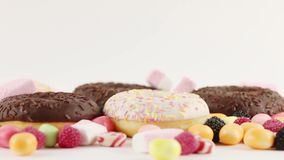 Donuts and candies and marshmallows stock video footage