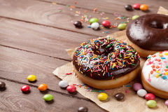 Donuts and candies Stock Photography