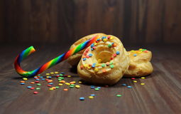 Donuts with caramel and color confectionery powder Royalty Free Stock Images