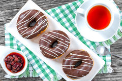 Donuts with Chocolate Icing, a cup of tea, top view Royalty Free Stock Photo
