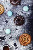 Donuts with chocolate and macaroons on a dark background Royalty Free Stock Photography
