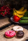 Donuts and chocolate muffin on burlap stock photography