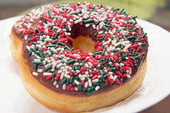 Donuts with Christmas Sprinkles Front Closeup Stock Photo