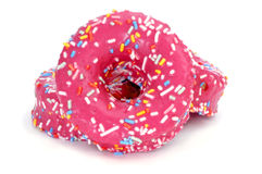 Donuts coated with a pink frosting and sprinkles of different co Royalty Free Stock Photos