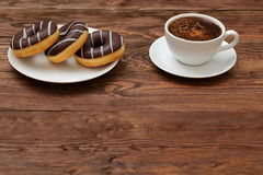 Donuts and coffee. Aromatic coffee and sweets are a great combination for a breakfast break Royalty Free Stock Photos