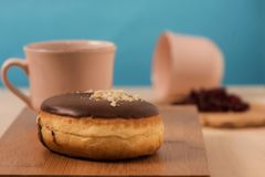 Donuts with coffee and blue background. Dual delicious Stock Image