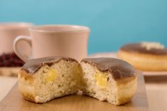Donuts with coffee and blue background Stock Photography