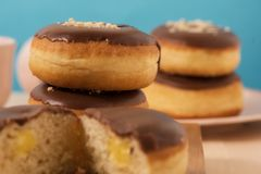 Donuts with coffee and blue background. Good condition for dessert Royalty Free Stock Images