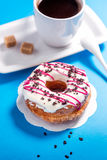 Donuts and coffee on blue background Stock Image