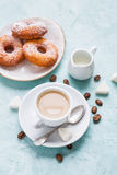 Donuts and coffee on blue background. Royalty Free Stock Photography