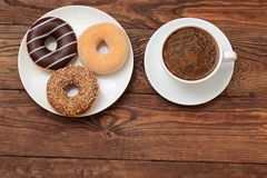 Donuts and coffee. Buds are sweets which you can not resist Stock Images