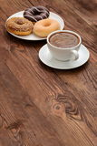 Donuts and coffee. Buds are sweets which you can not resist Stock Image