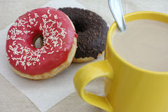 Donuts and coffee cup with milk Royalty Free Stock Image